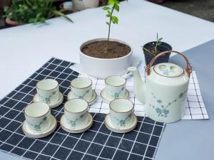 Bộ ấm tích men kem sen vẽ hoa đào xanh 1,4 lít